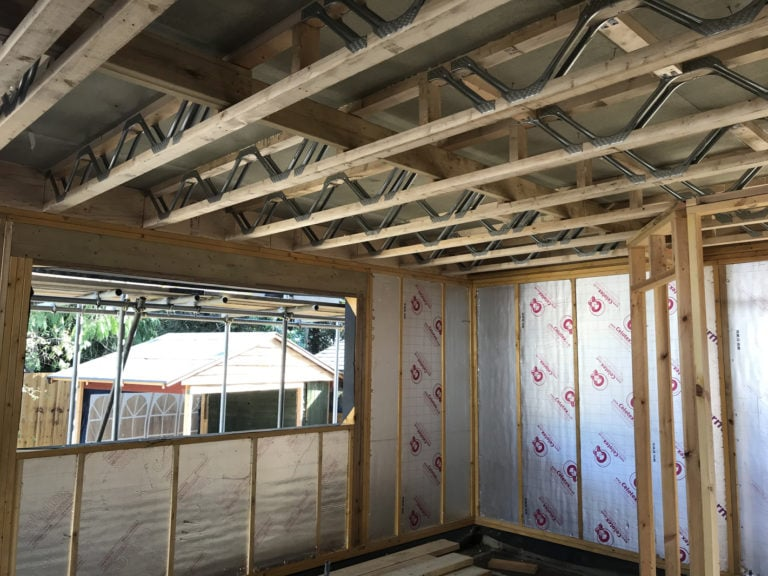 A timber framed extension under construction