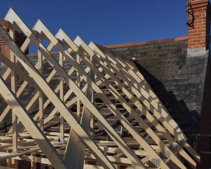 A timber framed extension under construction