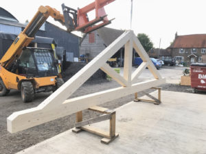A feature roof truss for a timber framed house