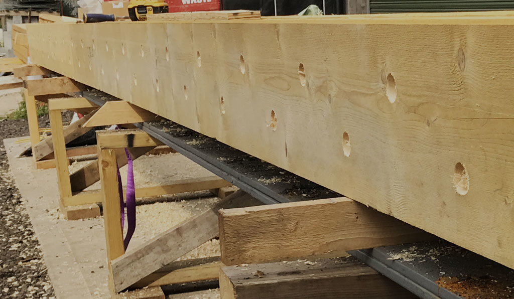 A timber frame panel under construction
