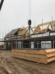A timber framed house under construction
